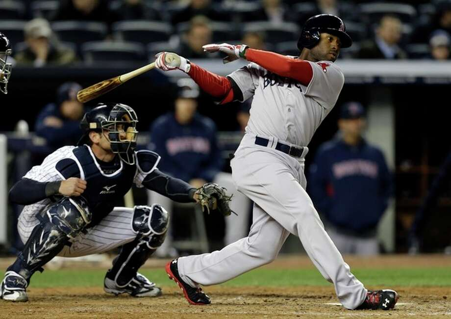 Boston Red Sox's Jackie Bradley, right, hits a seventh-inning RBI double against the New York Yankees in a baseball game at Yankee Stadium in New York, Thursday, April 4, 2013. (AP Photo/Kathy Willens) / AP