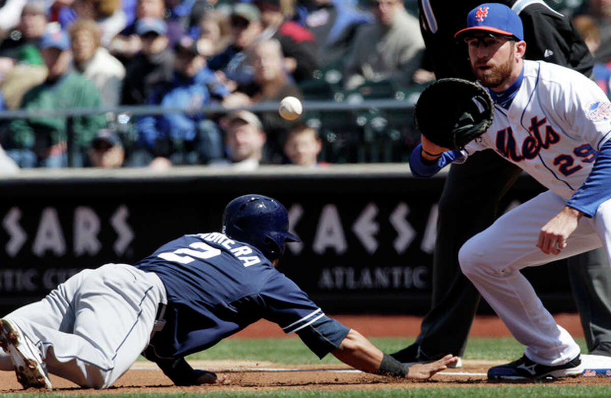 San Diego Padres' Everth Cabrera slides safely back to first base as New York Mets first baseman Ike Davis takes a pick-off throw from pitcher Dillon Gee during the first inning of a baseball game, Thursday, April 4, 2013 at Citi Field in New York. (AP Photo/Mark Lennihan)