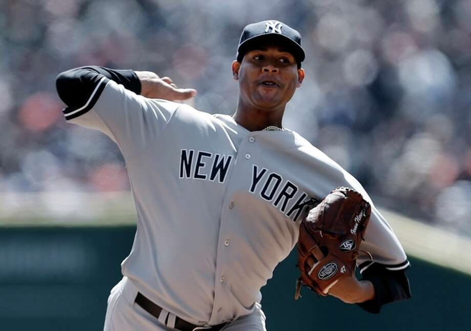 New York Yankees pitcher Ivan Nova throws against the Detroit Tigers during the first inning of a baseball game in Detroit, Friday April 5, 2013. (AP Photo/Paul Sancya) / AP