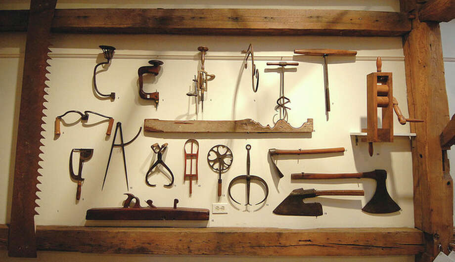 Hour Photo/Alex von Kleydorff . Tools were a gift to the Historical Society by Walt Smith / 2013 The Hour Newspapers