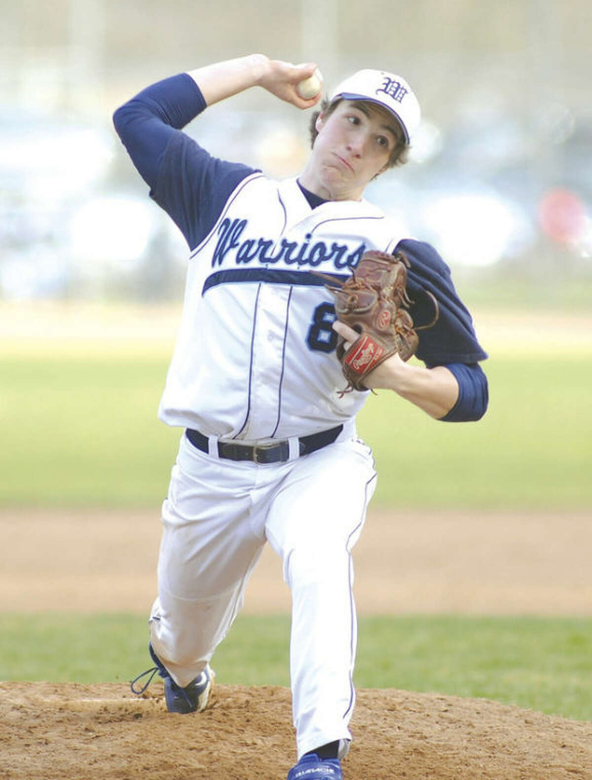 Hour photo/John Nash Ryan Reuther of Wilton fires a pitch to the plate while tossing a no-hitter against Weston on Thursday afternoon. Reuther beat Weston, 5-0.