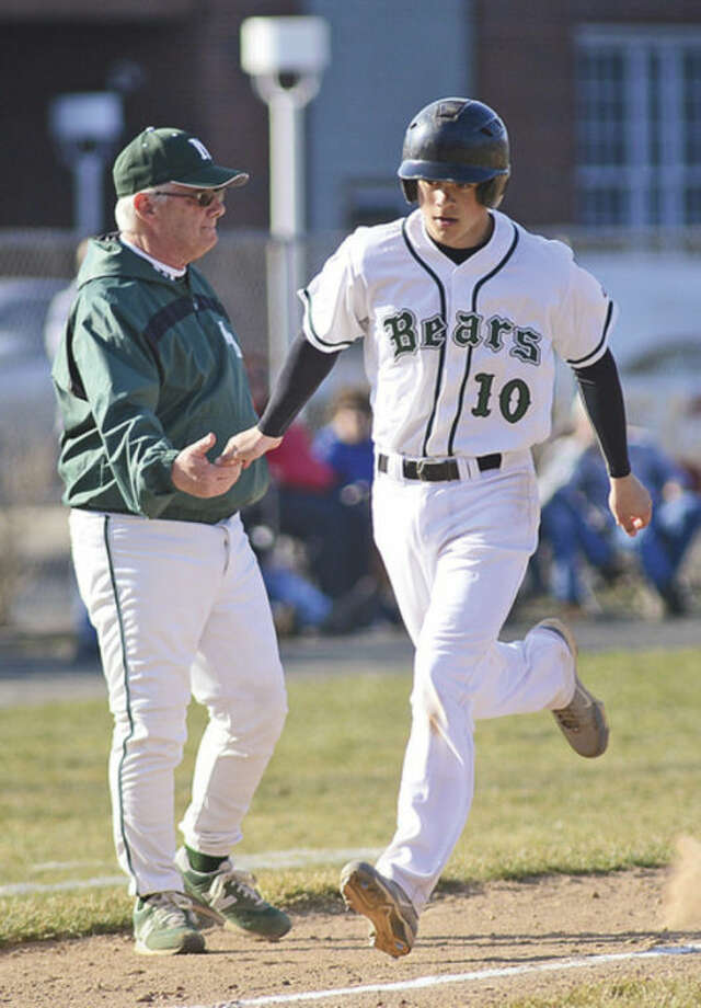 Hour photo/Erik TrautmannNorwalk's Dave Balunek slaps hands with head coach Pete Tucci as he rounds third after hitting a solo home run during Friday's game against Danbury at Malmquist Field. It was the only run Norwalk would get in an 8-1 loss.