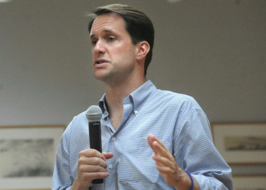 Hour photo / Matthew VinciRep. Jim Himes holds a town meeting Sunday at the Westport Public Library.