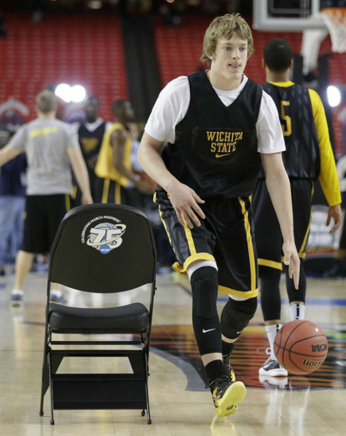 Wichita State's Ron Baker moves the ball during practice for their NCAA Final Four tournament college basketball semifinal game against Louisville, Friday, April 5, 2013, in Atlanta. Wichita State plays Louisville in a semifinal game on Saturday. (AP Photo/David J. Phillip)