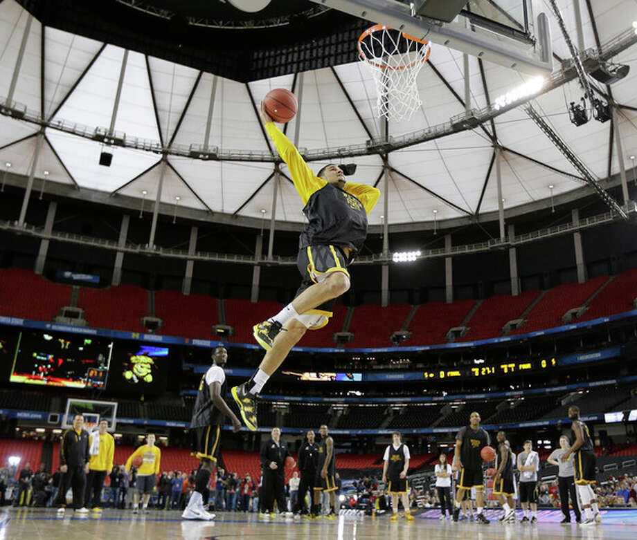 Wichita State's Fred Van Vleet works during practice for their NCAA Final Four tournament college basketball semifinal game against Louisville, Friday, April 5, 2013, in Atlanta. Wichita State plays Louisville in a semifinal game on Saturday. (AP Photo/David J. Phillip) / AP