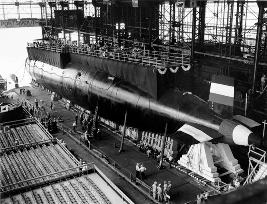 FILE- In this 1960 handout file photo provided by the U.S. Navy, the nuclear-powered submarine USS Thresher is prepared for launching at the Portsmouth Naval Shipyard in Kittery, Maine. Fifty years ago 129 men lost their lives when the sub sank during deep-dive testing off Cape Cod. The deadliest submarine disaster in U.S. history delivered a blow to national pride during the Cold War and became the impetus for safety improvements. (AP Photo/U.S. Navy, file) / Portsmouth Naval Shipyard