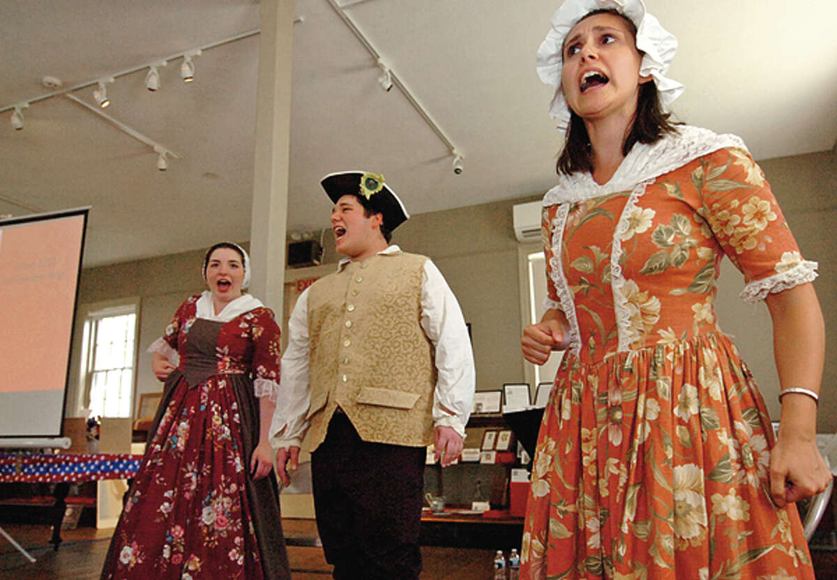 Allison Rohr, Max Helfand and Samantha Kulish sing a period song during The Norwalk Historical Society's Independence Day celebration Wednesday at Mill Hill Historic Park. Hour photo / Erik Trautmann