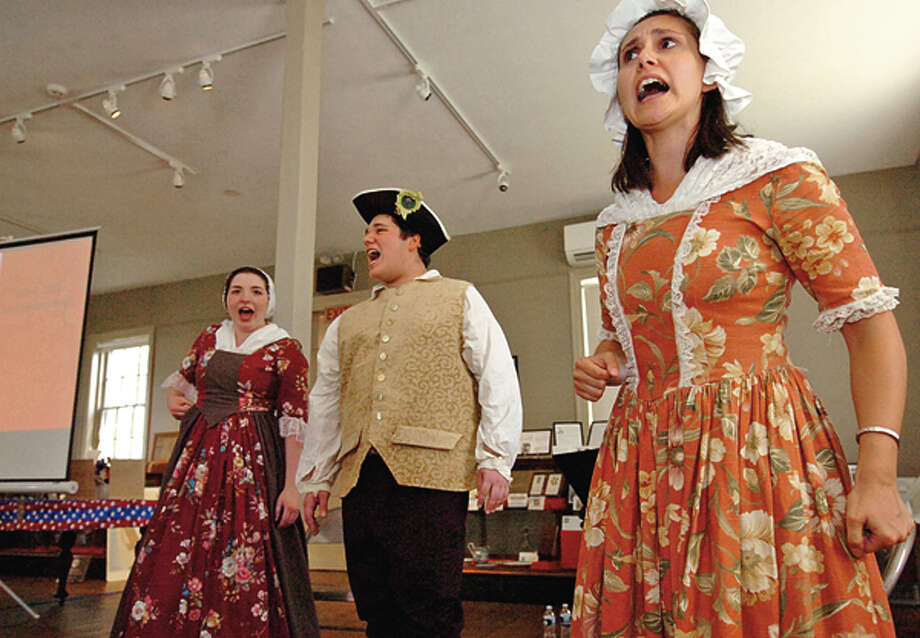 Allison Rohr, Max Helfand and Samantha Kulish sing a period song during The Norwalk Historical Society's Independence Day celebration Wednesday at Mill Hill Historic Park. Hour photo / Erik Trautmann / (C)2012, The Hour Newspapers, all rights reserved