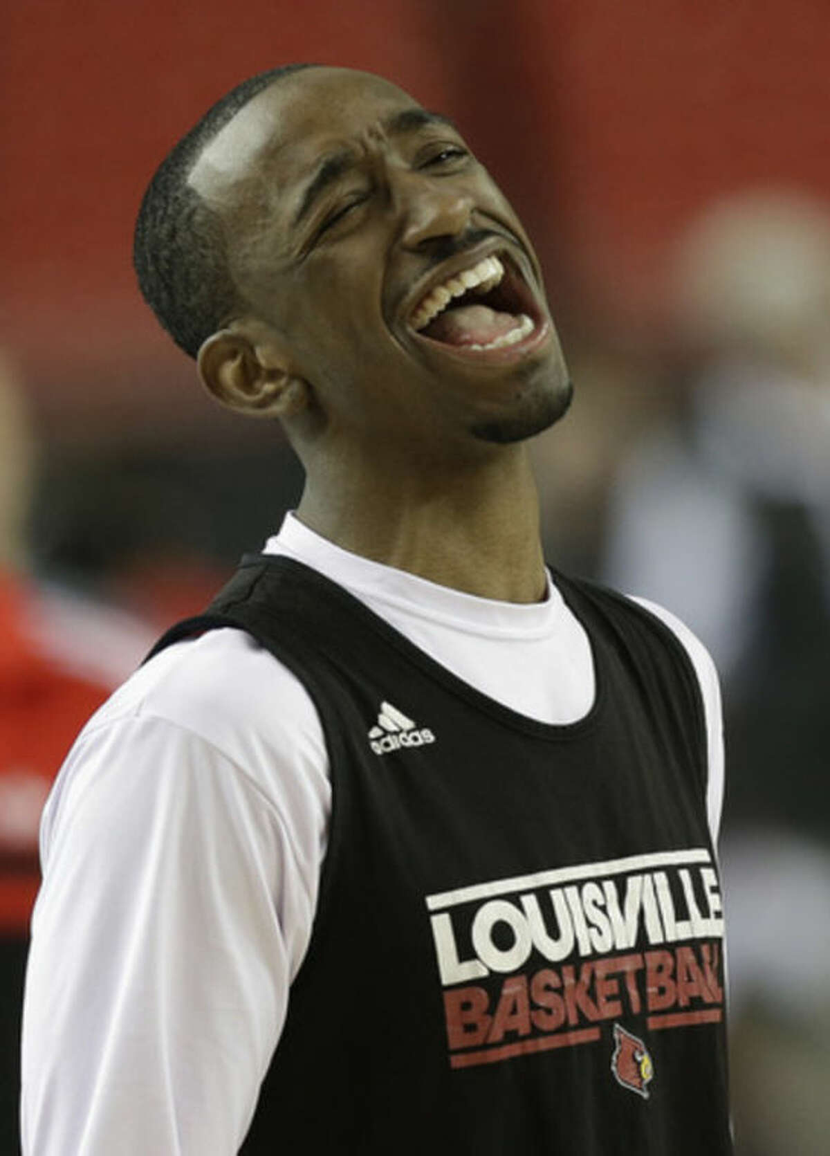 Louisville's Russ Smith reacts during practice for their NCAA Final Four tournament college basketball semifinal game against Wichita State Friday, April 5, 2013, in Atlanta. Louisville plays Wichita State in a semifinal game on Saturday. (AP Photo/John Bazemore)