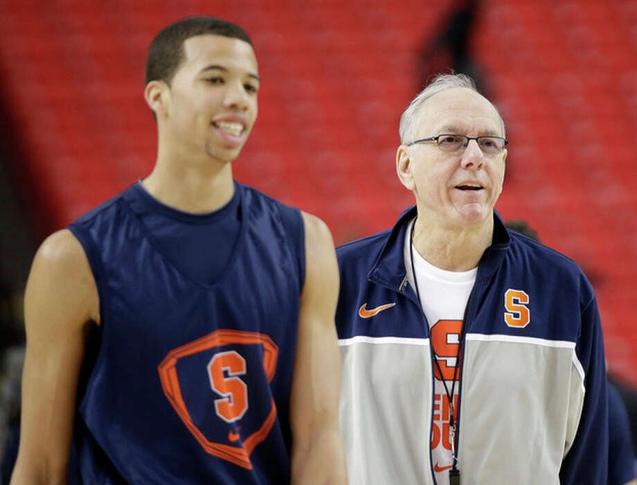 Syracuse's Michael Carter-Williams walks on the court with Syracuse head coach Jim Boeheim during practice the NCAA Final Four tournament college basketball semifinal game against Michigan, Friday, April 5, 2013, in Atlanta. Syracuse plays Michigan in a semifinal game on Saturday. (AP Photo/David J. Phillip) / AP