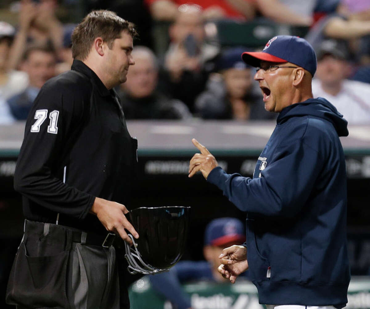 Cleveland Indians manager Terry Francona, right, argues with home plate umpire Jordan Baker in the fourth inning of a baseball game against the New York Yankees on Tuesday, April 9, 2013, in Cleveland. Francona was arguing after starting pitcher Carlos Carrasco was ejected from the game for hitting Yankees' Kevin Youkilis with a pitch. (AP Photo/Tony Dejak)