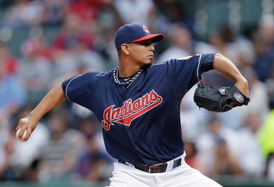 Cleveland Indians starting pitcher Carlos Carrasco throws in the first inning of a baseball game against the New York Yankees, Tuesday, April 9, 2013, in Cleveland. (AP Photo/Tony Dejak) / AP