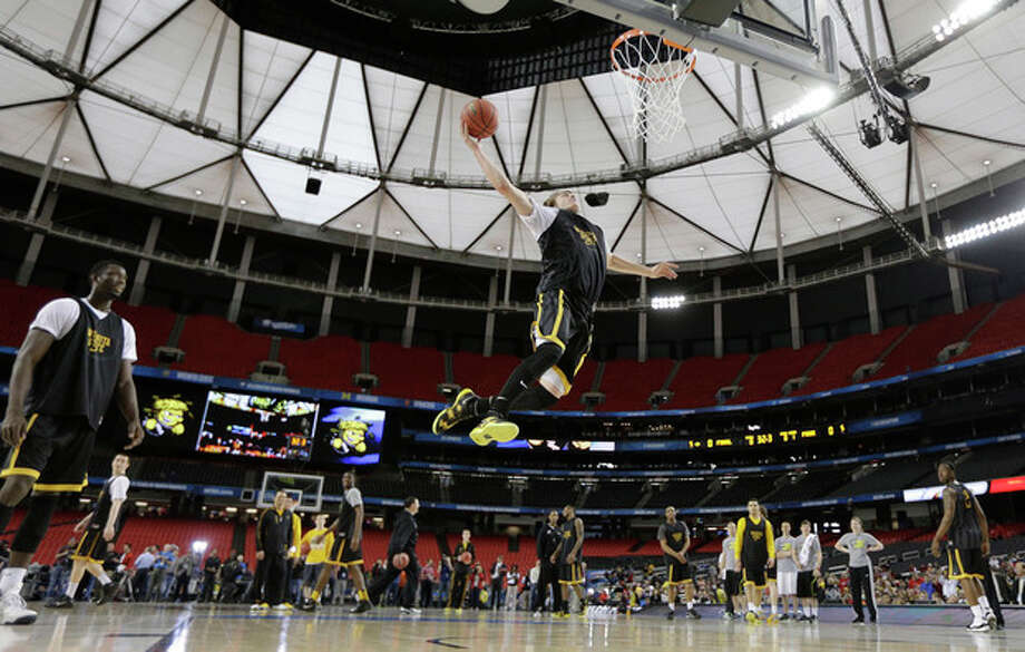 Wichita State's Ron Baker heads to the hoop during practice at the Final Four of the NCAA college basketball tournament, Friday, April 5, 2013, in Atlanta. Wichita State plays Louisville in a national semifinal on Saturday. (AP Photo/David J. Phillip) / AP