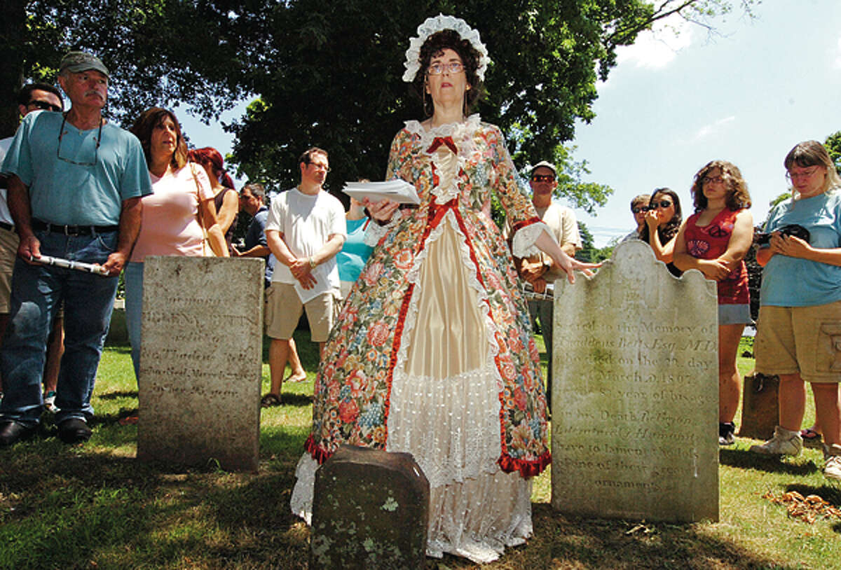 Medeleine Eckert leads at tour of the cemetary during The Norwalk Historical Society's Independence Day celebration Wednesday at Mill Hill Historic Park. Hour photo / Erik Trautmann