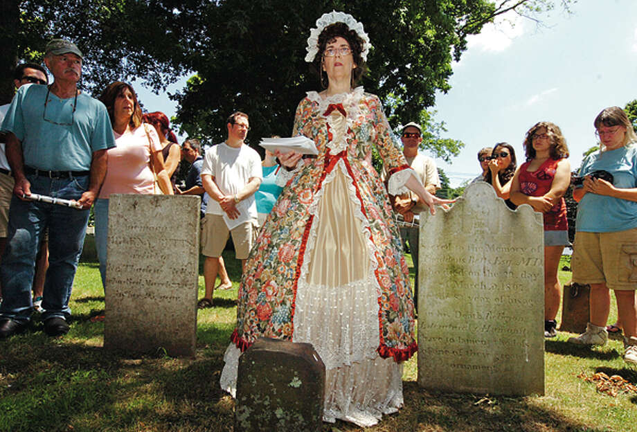Medeleine Eckert leads at tour of the cemetary during The Norwalk Historical Society's Independence Day celebration Wednesday at Mill Hill Historic Park. Hour photo / Erik Trautmann / AP