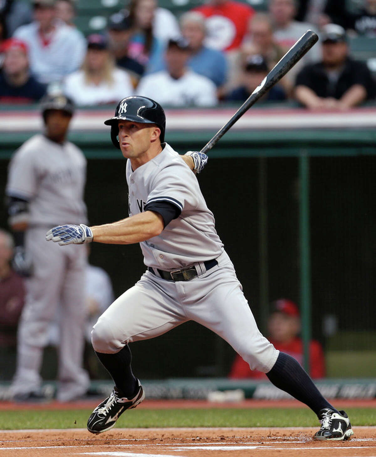 New York Yankees' Brett Gardner watches his double off Cleveland Indians starting pitcher Carlos Carrasco in the first inning of a baseball game, Tuesday, April 9, 2013, in Cleveland. (AP Photo/Tony Dejak)