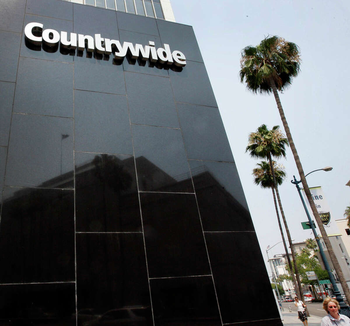 FILE - This June 25, 2008, file photo, shows the Countrywide Financial Corp. office in Beverly Hills, Calif. The former corporation, whose subprime loans helped start the nation's foreclosure crisis, made hundreds of discount loans to buy influence with members of Congress, congressional staff, top government officials and executives of troubled mortgage giant Fannie Mae, according to a Congressional House report. (AP Photo/Kevork Djansezian, File)