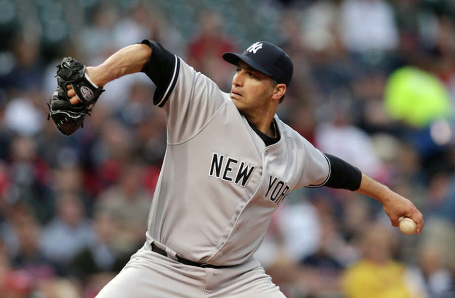 New York Yankees starter Andy Pettitte pitches in the first inning of a baseball game against the Cleveland Indians, Tuesday, April 9, 2013, in Cleveland. (AP Photo/Tony Dejak) / AP
