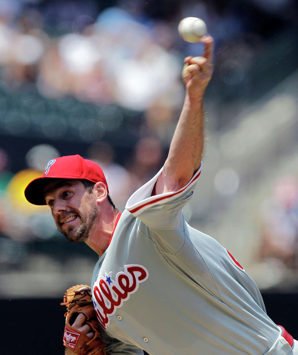 Philadelphia Phillies starting pitcher Cliff Lee delivers against the New York Mets during the third inning of their baseball game at Citi Field in New York, Wednesday, July 4, 2012. (AP Photo/Kathy Willens)