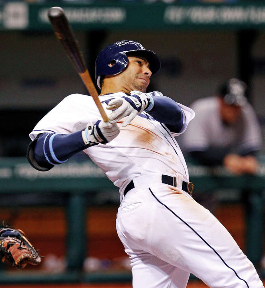 Tampa Bay Rays' Carlos Pena follows through on a two-run home run during the seventh inning of a baseball game against the New York Yankees, Wednesday, July 4, 2012, in St. Petersburg, Fla. (AP Photo/Mike Carlson) / FR155492 AP
