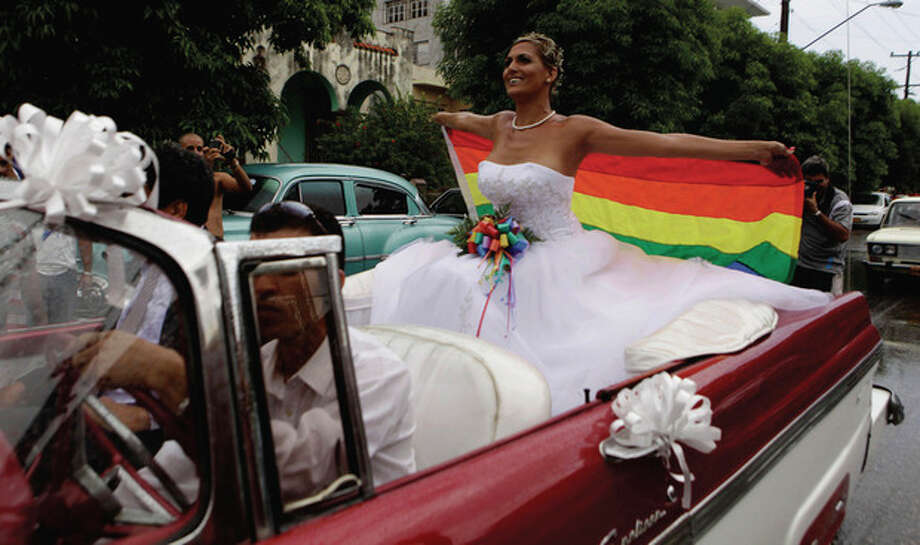 Transsexual Wendy Iriepa rides in a classic car to her wedding in Havana, Cuba, Saturday Aug. 13, 2011. Iriepa, whose sex change operation was paid for by the state, tied the knot with Ignacio Estrada in a first-of-its-kind wedding for Cuba. Gay marriage is not legal in Cuba and Saturday's wedding does nothing to change that since Iriepa is legally considered a woman. (AP Photo/Javier Galeano) / AP