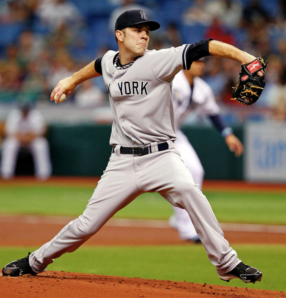 New York Yankees starting pitcher David Phelps throws during the first inning of a baseball game against the Tampa Bay Rays, Wednesday, July 4, 2012, in St. Petersburg, Fla. (AP Photo/Mike Carlson)