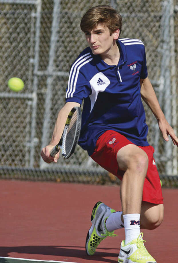 Hour photo/Erik TrautmannBrien McMahon's Zach Ely returns to Norwalk's Seiji Hosokawa during the No. 1 singles match at Tuesday's clash of the city rivals. Ely edged Hosokawa in the match that provided the Senators with the deciding point in the match.