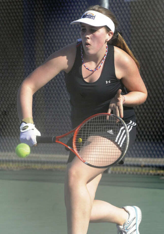 Hour photo/Matthew VinciBrien McMahon's Rebecca Link returns during the No. 1 singles match against Norwalk's Jacqui O'Hara Tuesday. Link was the winner.