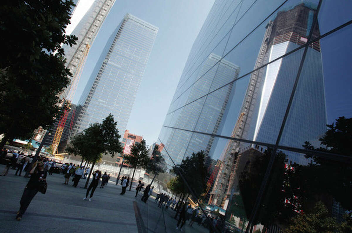 New construction is reflected in glass during the first day that the 9/11 memorial plaza was opened to the public at the World Trade Center site in New York, Monday, Sept. 12, 2011. (AP Photo/Mike Segar, Pool)