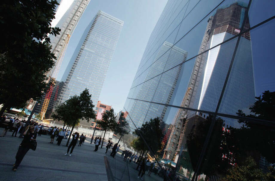 New construction is reflected in glass during the first day that the 9/11 memorial plaza was opened to the public at the World Trade Center site in New York, Monday, Sept. 12, 2011. (AP Photo/Mike Segar, Pool) / POOL Reuters