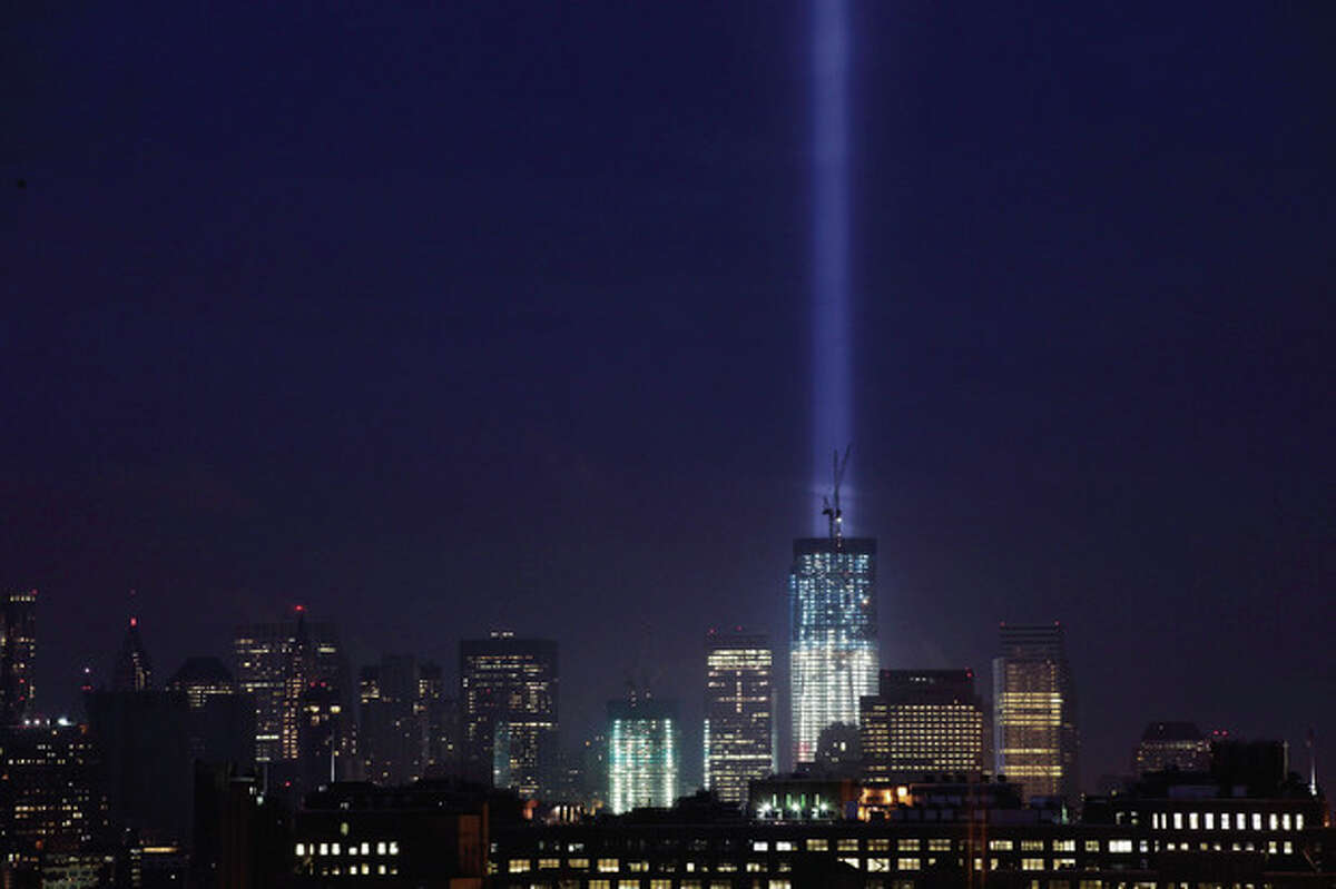 The Tribute in Light rises above 1 World Trade Center and ground zero, Monday, Sept. 12, 2011 in New York. (AP Photo/Mark Lennihan)