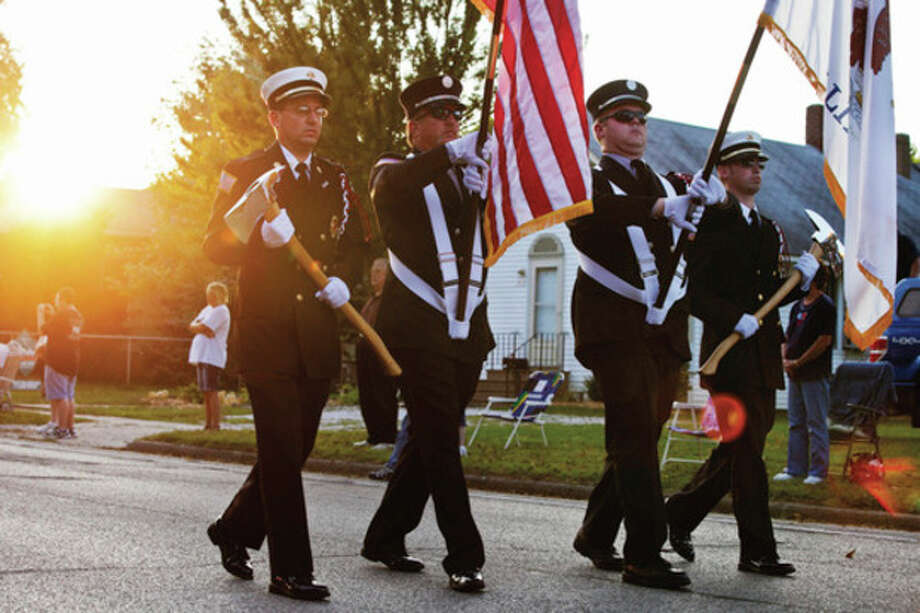 Henry, Ill. firefighters lead an emergency vehicle procession to Henry Central Park for a 9/11 memorial service on Sunday, Sept. 11, 2011, in Henry, Ill. An estimated 50 police, fire, and EMS departments were in attendance at the event. (AP Photo/Eve Edelheit/Peoria Journal Star) / Peoria Journal Star