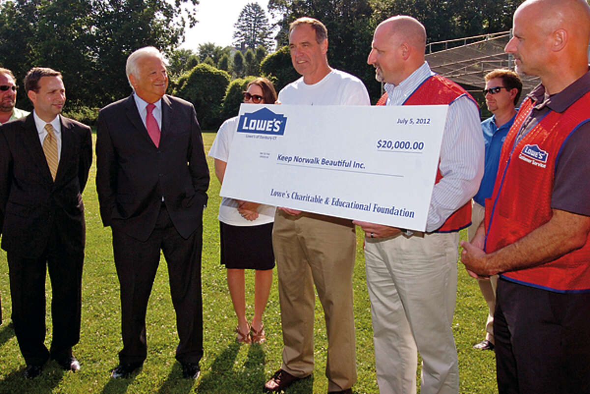 Keep Norwalk Beautiful chairman, David Shockley, center receives a check for $20,000 from Lowe's representatives Joe Sterlein and Steven Frankilin to build a pavillion at Flax Hill Park while Stete Senator Bob Duff and Mayor Richard Moccia look on during a check passing ceremony Thursday morning. Hour photo / Erik Trautmann