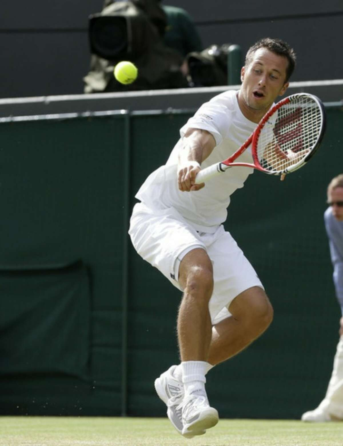 Philipp Kohlschreiber of Germany plays a shot to Jo-Wilfried Tsonga of France during a quarterfinals match at the All England Lawn Tennis Championships at Wimbledon, England, Wednesday, July 4, 2012. (AP Photo/Kirsty Wigglesworth)