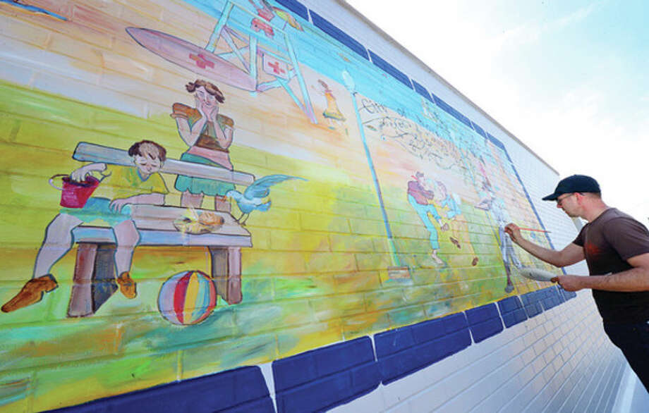 Hour photo / Erik TrautmannBrushstrokesArtist Ziggy Bober paints a mural at Calf Pasture Beach Tuesday as warm weather finally hits the area. / (C)2013, The Hour Newspapers, all rights reserved