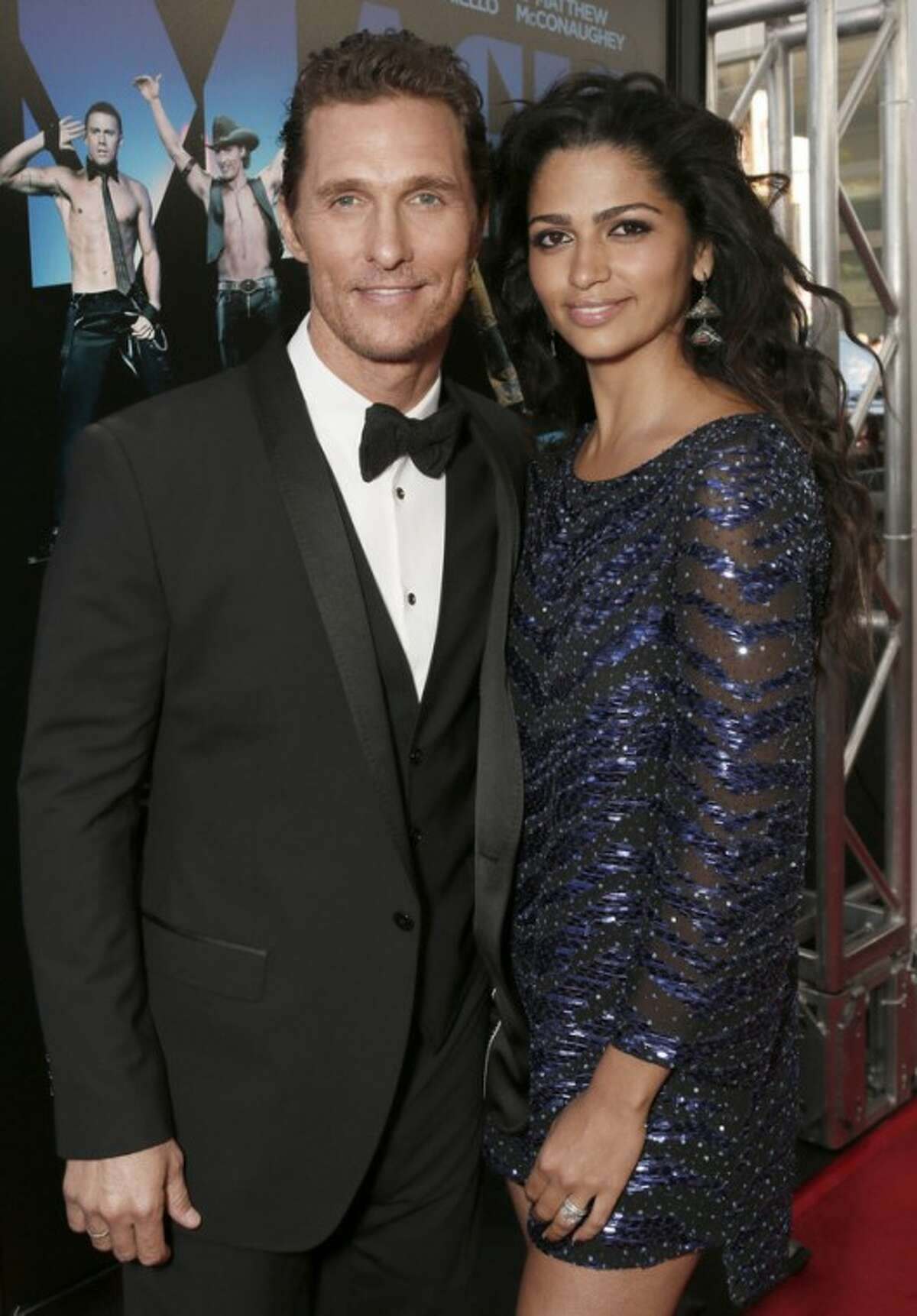 """FILE - This June 24, 2012 file photo shows actor Matthew McConaughey and his wife Camila Alves McConaughey attending the premiere of """"Magic Mike"""" at Regal Cinemas L.A. Live in Los Angeles. McConaughey and Alves both tweeted, Wednesday, July 4, 2012, that they were expecting their third child. Forty-two-year-old McConaughey wed 29-year-old Alves last month in a ceremony at their Austin, Texas home. The couple have a son named Levi, who turns 4-years-old this week and a 2-year-old daughter named Vida. (Photo by Todd Williamson/Invision/AP, file)"""
