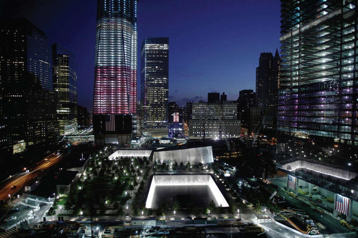 One World Trade Center and the National September 11 Memorial are seen, Monday, Sept. 12, 2011, in New York. (AP Photo/Matt Rourke)