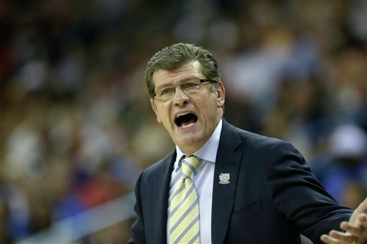 Connecticut head coach Geno Auriemma reacts to play against Louisville during first half of the national championship game of the women's Final Four of the NCAA college basketball tournament, Tuesday, April 9, 2013, in New Orleans. (AP Photo/Gerald Herbert)