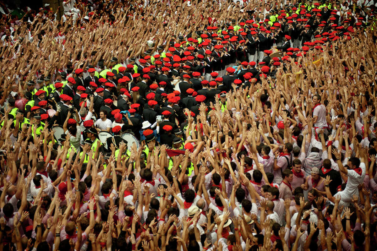 The music band plays after the 'Chupinazo', the official opening of the 2012 San Fermin fiestas, Friday, July 6, 2012 in Pamplona, Spain. Revelers from around the world kick off the San Fermin festival with a messy party in the Pamplona town square, one day before the first of eight days of the running of the bulls. (AP Photo/Daniel Ochoa de Olza)