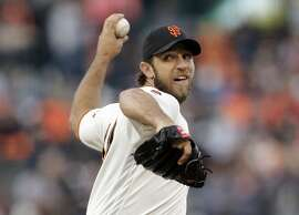 San Francisco Giants starting pitcher Madison Bumgarner throws to the Milwaukee Brewers during the first inning of a baseball game Tuesday, June 14, 2016, in San Francisco. (AP Photo/Marcio Jose Sanchez)