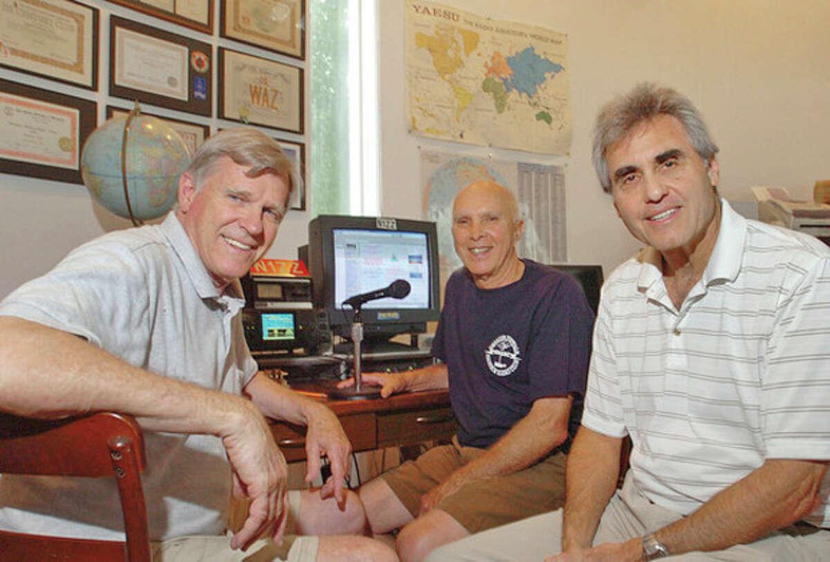 Hour photo / Erik Trautmann Norwalk HAM radio enthusiasts, Gus Hedland, Dan Gravareaux and Jay Kolinski.