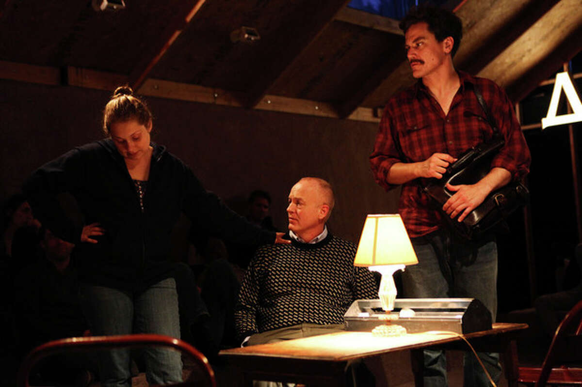"""This undated theater image released by Blake Zidell & Associates shows, from left, Merritt Wever, Reed Birney and Michael Shannon, in a scene from Annie Baker's adaptation of """"Uncle Vanya"""", performing off-Broadway at Soho Rep in New York. (AP Photo/Blake Zidell & Associates, Julieta Cervantes)"""