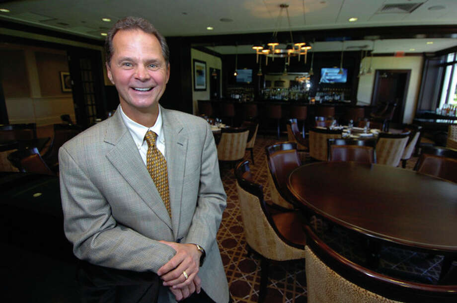 Photo by Alex von Kleydorff. Rolling Hills Country Club General Manager Michael L. Catanzaro in the Tap Room. / 2011 The Hour Newspapers