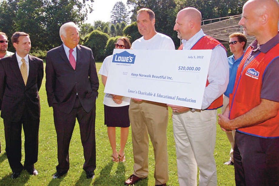 Hour photo / Erik TrautmannKeep Norwalk Beautiful Chairman David Shockley, center, receives a check for $20,000 from Lowe's representatives Joe Sterlein and Steven Frankilin to build a pavillion at Flax Hill Park while Sen. Bob Duff, D-25, and Mayor Richard A. Moccia look on Thursday. / (C)2012, The Hour Newspapers, all rights reserved