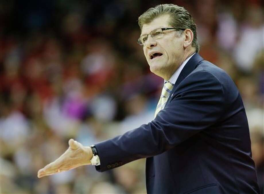 Connecticut head coach Geno Auriemma argues a call during first half of the national championship game against Louisville at the women's Final Four of the NCAA college basketball tournament, Tuesday, April 9, 2013, in New Orleans. (AP Photo/Gerald Herbert) / AP
