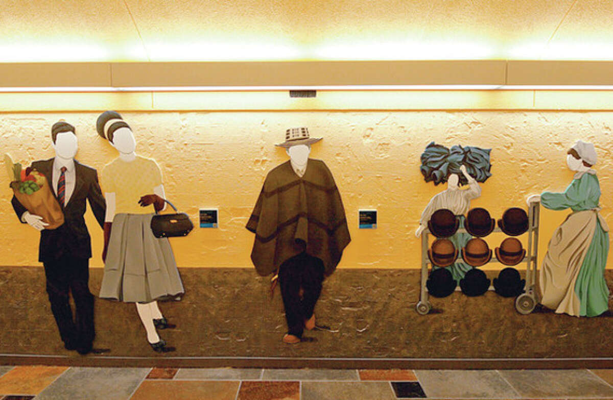 Hour photos / Erik Trautmann Local artist Duvian Montoya whose work is popping up locally in prominent places has a permanent exhibition, Silloutted Faces and Period Pieces, at the Sono train station as part of the Art in Parking Places initiative in Norwalk.