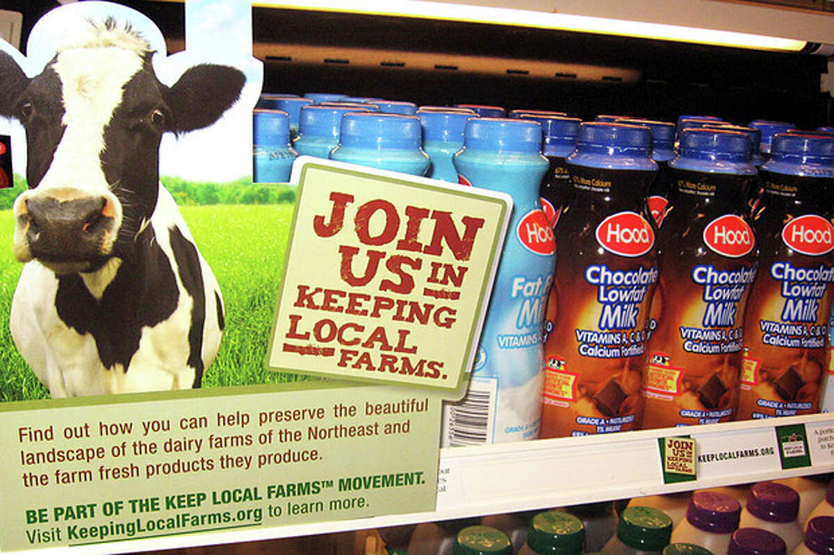 In this Dec. 17, 2009 photo released by the University of Vermont, milk is displayed with a Keep Local Farms sign in Burlington, Vt. The Keep Local Farms program _ set up in 2009, a year of record low milk prices paid to farmers _ urges colleges, universities and other institutions in New England to charge a little more for their milk, with the proceeds going to dairy farmers in the region. which has lost 66 percent of its dairy farms in 30 years due to low milk prices paid to farmers, and high feed, fuel and labor costs. (AP Photo/University of Vermont)