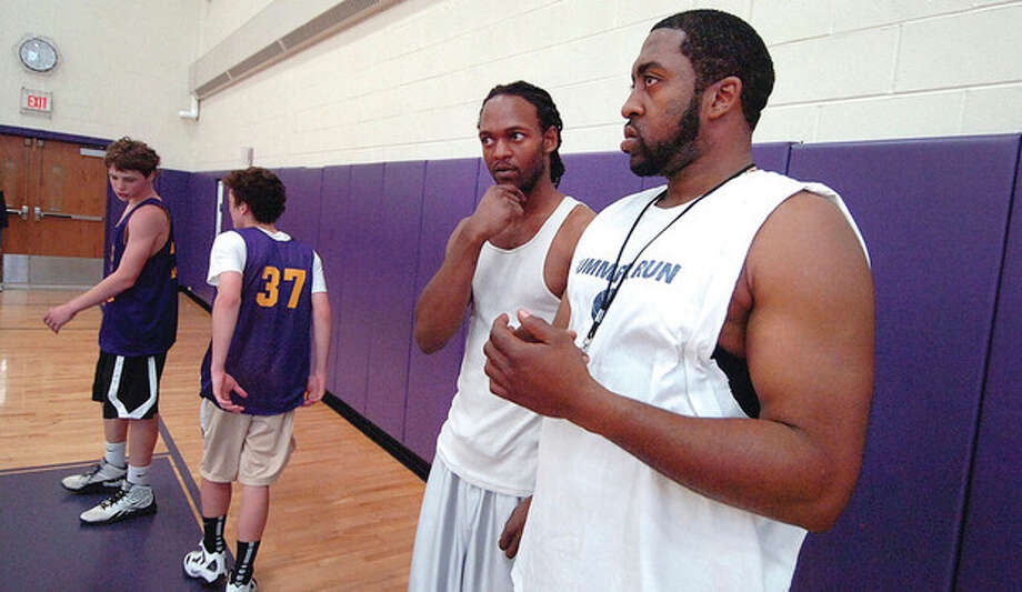 Hour photo/ Alex von KleydorffZach Wrentz, left, and Charles Miller coach Stamford Peace. / 2012 The Hour Newspapers