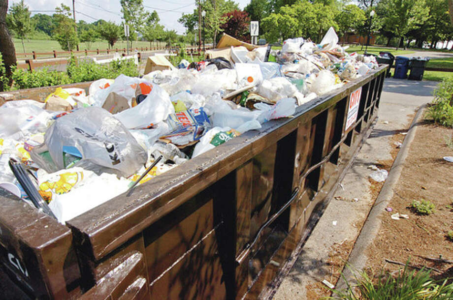 Garbage piled up Thursday morning at Shady Beach following the Independance Day holiday Wednesday when beachgoers jammed the park.Hour photo / Erik Trautmann / (C)2012, The Hour Newspapers, all rights reserved