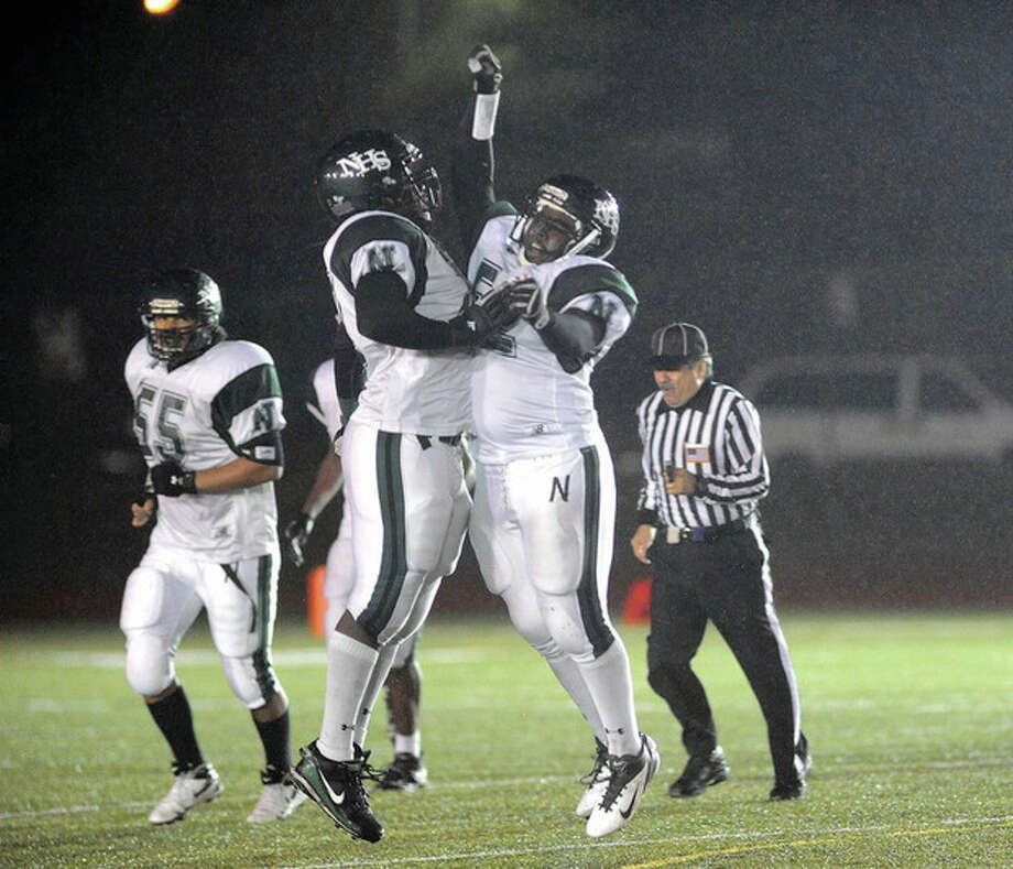 Hour Photo/John Nash Norwalk's Brandon Rembert, right, and Kwazee Rice celebrate a fumble recovery during the third quarter of Tuesday's Class LL state quarterfinal against Conard in West Hartford. The Bears advanced with a 21-15 victory.